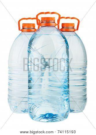 Three Big Full Plastic Water Bottles With Orange Caps
