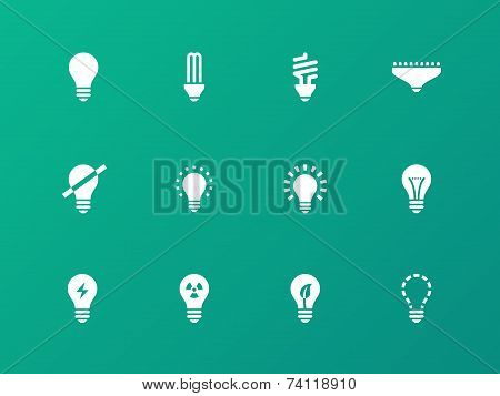 Light bulb and CFL lamp icons on green background.