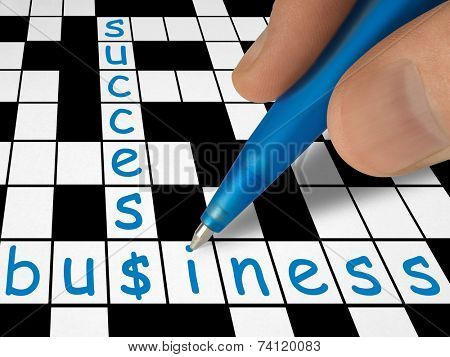 Crossword - business and success, hand with pen