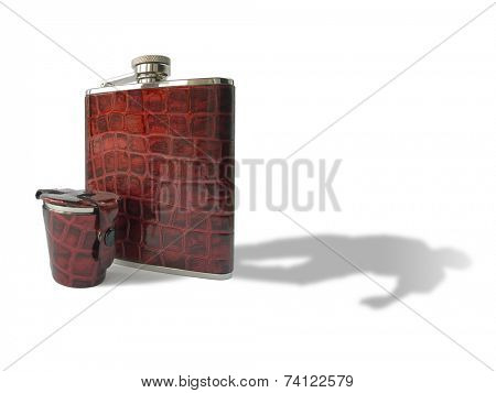 Hipflask and glass, shadow like a drunken man, isolated on white
