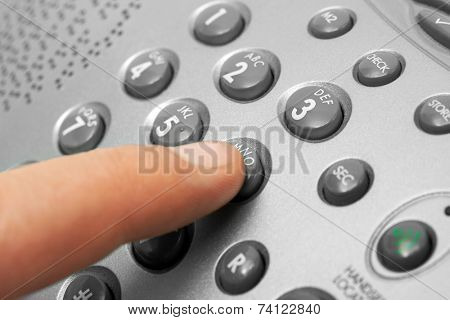 Finger and phone keypad, business background