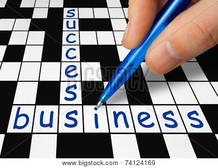 Hand filling in crossword - business and success