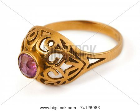 Macro of gold ring isolated on white background