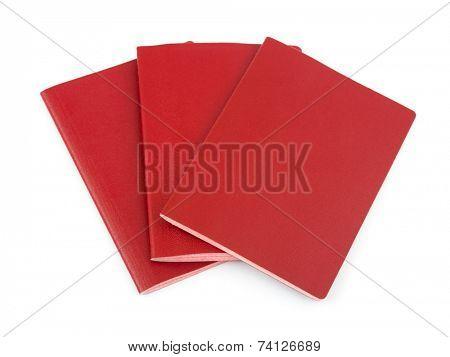 Three blank passports isolated on white background