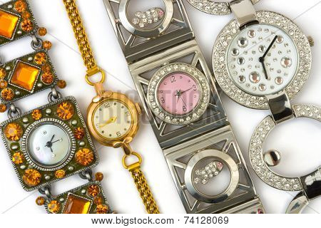 Group of woman watches on white background