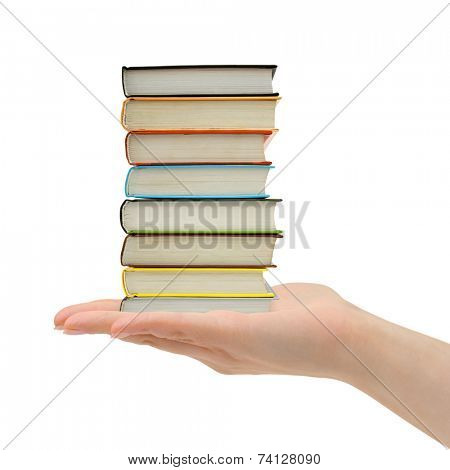 Stack of books in hand isolated on white background