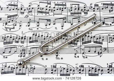 Pitchfork on sheet music, abstract art background