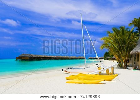Yacht on tropical beach - travel vacation background