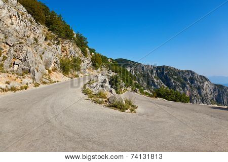 Old road in mountains - abstract travel background