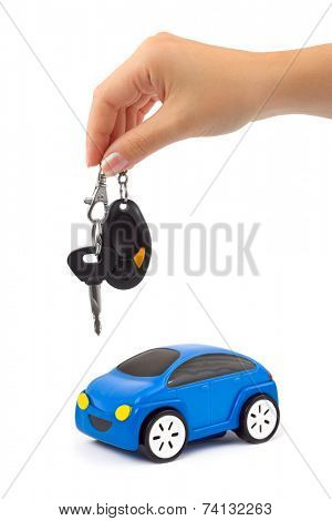 Car and hand with keys isolated on white background