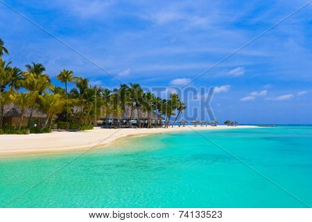 Beach bungalows on a tropical island - vacation background