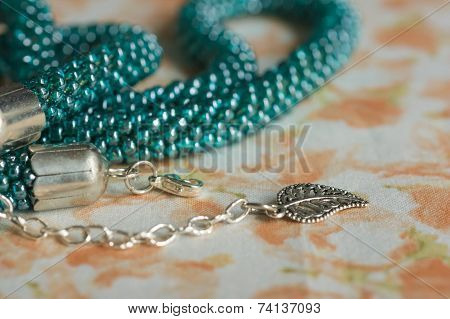 Fragments Of A Knitted Necklace From Beads Of Color Aquamarine