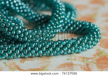 Beads Of Color The Aquamarine Connected In The Form Of A Plait