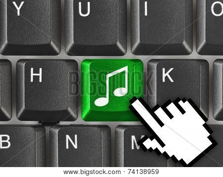Computer keyboard with music key - technology background