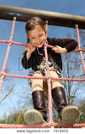 Girl climbing a rope ladder