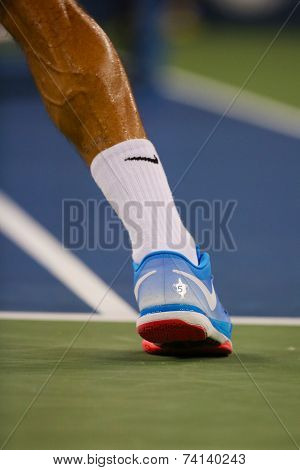 Seventeen times Grand Slam champion Roger Federer wears custom Nike tennis shoes during US Open 2014