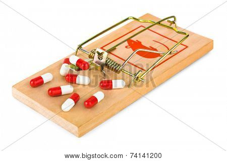 Mousetrap and pills isolated on white background