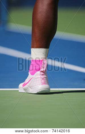Seventeen times Grand Slam champion Serena Williams wears custom Nike tennis shoes during US Open