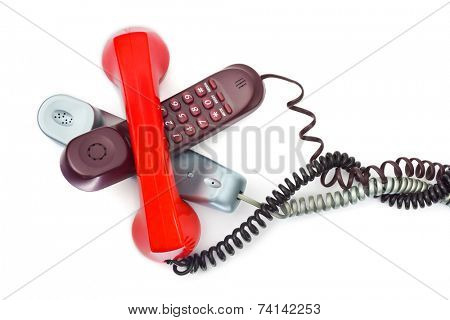 Heap of telephones isolated on white background
