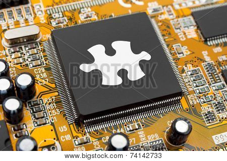Puzzle on computer chip - technology background