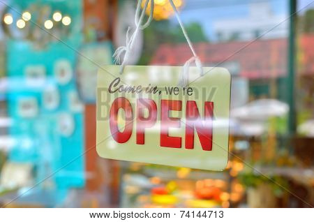 Open Sign Broad Through The Glass Of Window