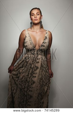 Well-dressed Female Model On Grey Background