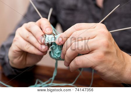 Closeup Of Knitting Male Hands
