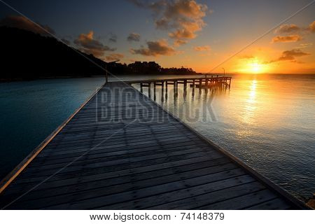 The Landscape Of Beautiful Wooden Bridge With Sunrise