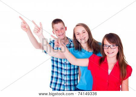 Happy Teenagers Pointing Up To Copy Space