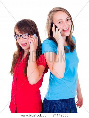 Girls Talking Together On Mobile Phone