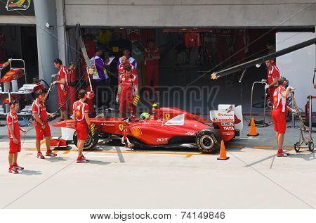 SEPANG, MALAYSIA - APRIL 8: Felipe Massa (team Scuderia Ferrari Marlboro) on the pit at first practice on Formula 1 GP, April 8 2011, Sepang, Malaysia