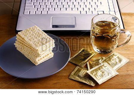 Soda Crackers, cup of tea and a computer