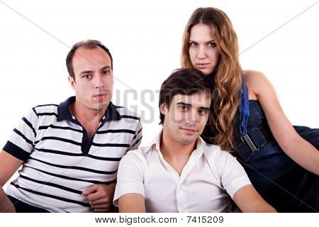 Two Men And A Woman Sitting On The Couch