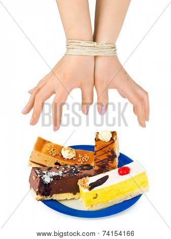 Cakes and bound hands isolated on white background