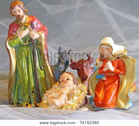 Holy Family In The Tradition Of Christmas With Doneky And Ox