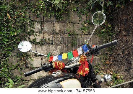 Tibetan Buddhist prayer flags on a motorbike