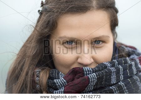 Smiling girl with a big scarf