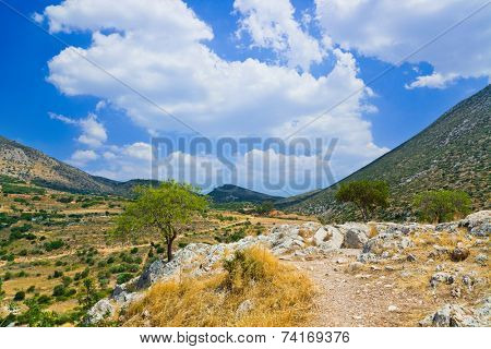 Pathway to mountains in Mycenae, Greece - travel background