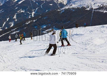 Skiers at mountains ski resort Bad Gastein Austria - nature and sport background