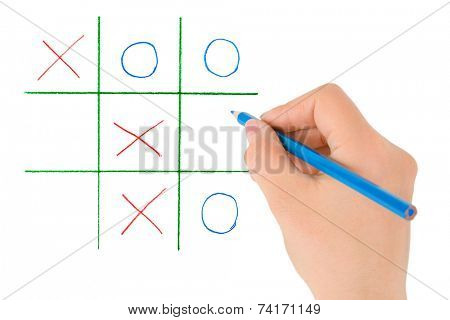 Hand with pencil and game isolated on white background