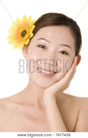 Smiling Girl With Yellow Flower