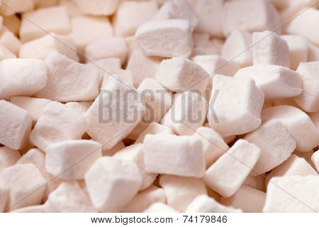 Tender white marshmallow pieces background
