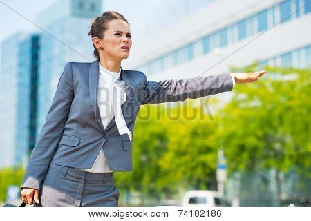 Portrait Of Concerned Business Woman In Office District Catching