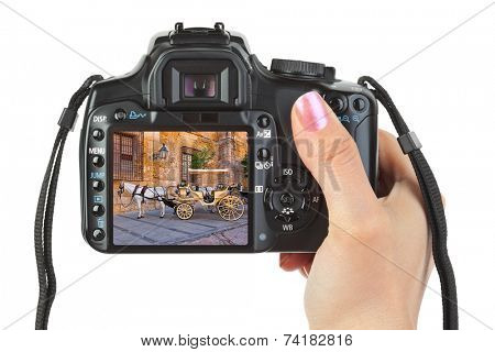 Camera in hand and Spain view (my photo) isolated on white background