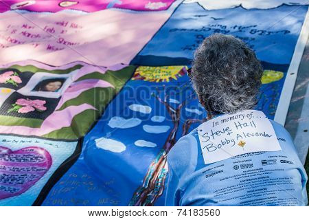 Woman Viewing Section Of Aids Quilt