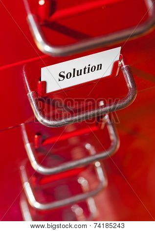Red file cabinet with card Solution - business background