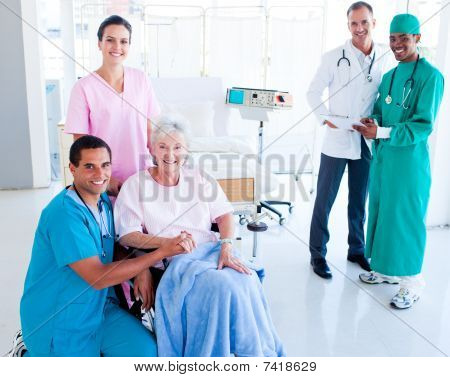 Attentive Medical Team Taking Care Of A Senior Woman