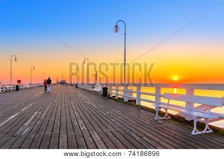 Sunrise at wooden pier (molo) in Sopot, Poland
