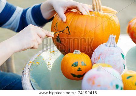 Hollowing Out A Pumpkin To Prepare Halloween Lantern