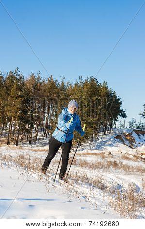 Elderly Woman On Ski Walk